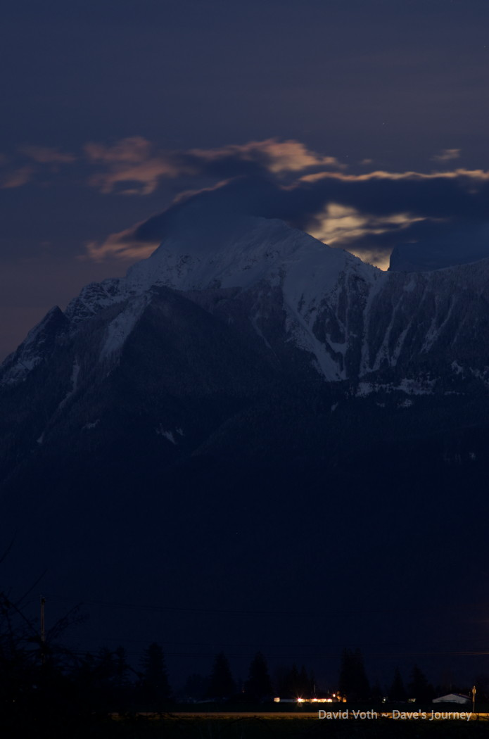 Photo of moon rising behind Mt. Cheam